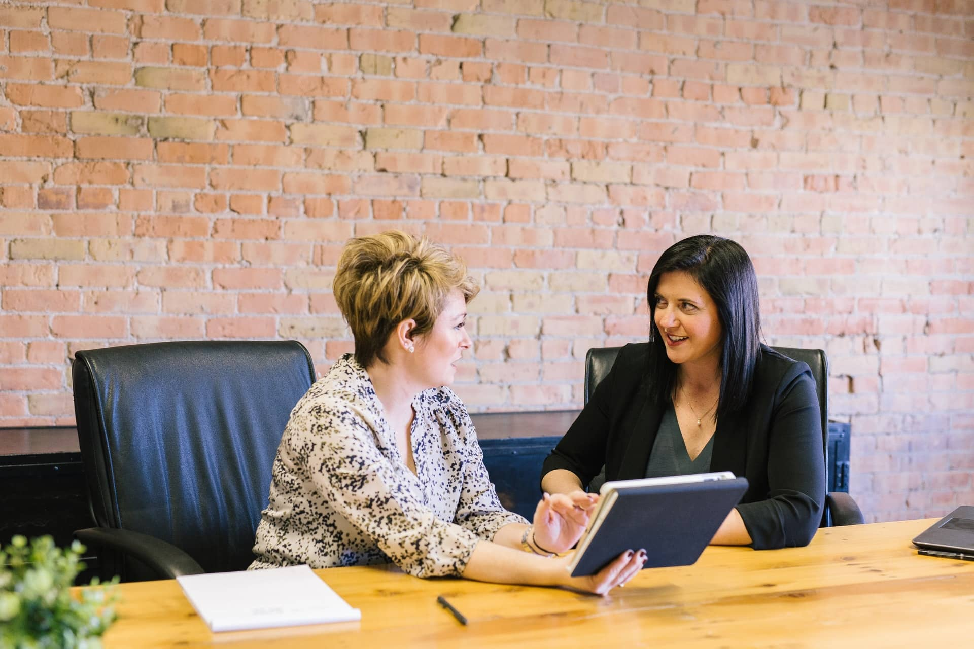two women sitting at a meeting table
