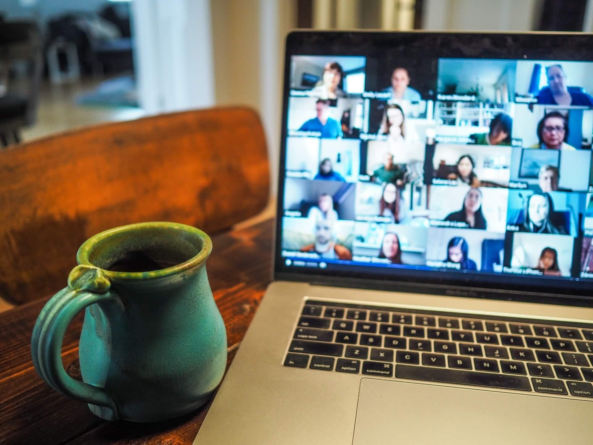 mug of coffee and zoom on laptop