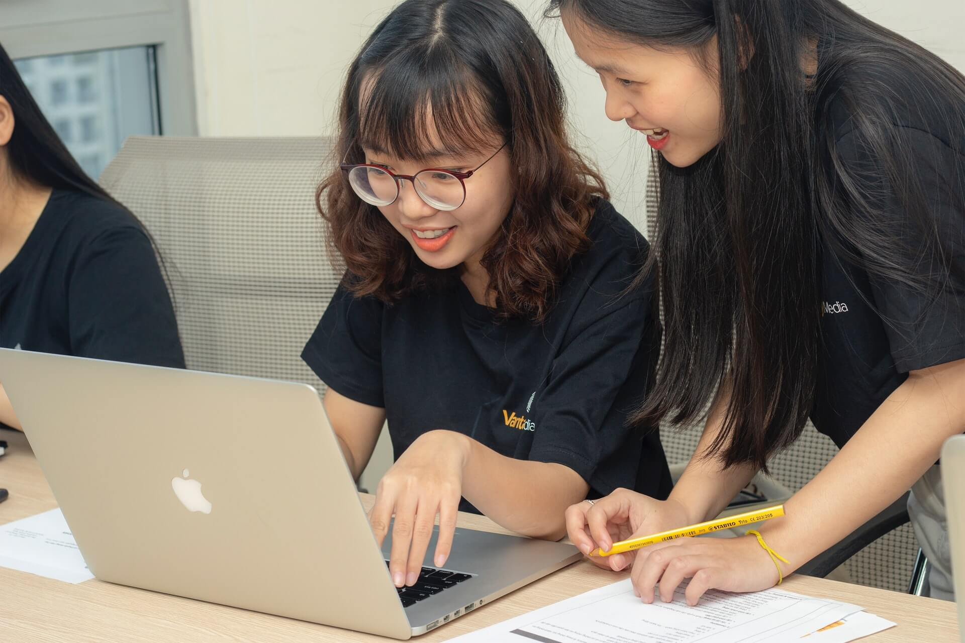 two girls working on laptop
