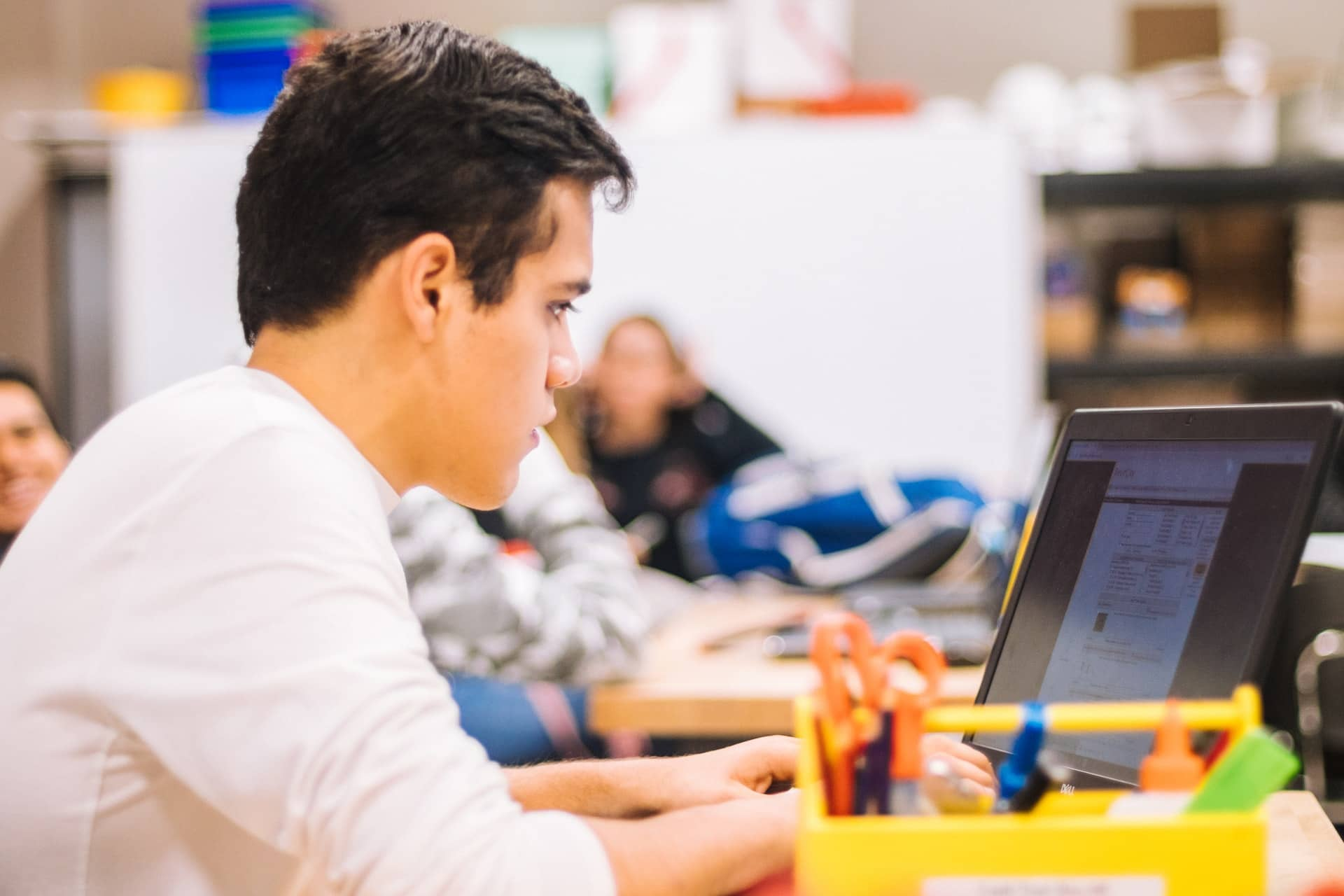 boy focused on laptop screen